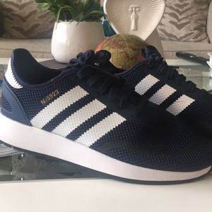 Navy blue and white Adidas.